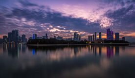 Sunset at Sharjah waterfront. This is a view of the waterfront of Sharjah reflected on the ocean Stock Photography