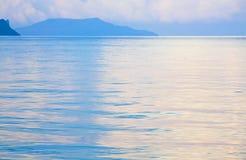 Sunset and shining sea surface Stock Photos