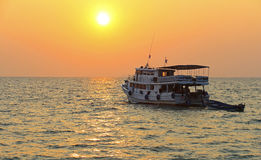 Sunset with ship in background, Thailand Stock Photos