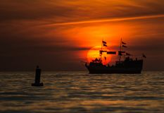 Sunset Ship in Fort Myers. Silhouette of a ship passing by Fort Myers beach Royalty Free Stock Photos