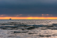 Sunset,the ship on the horizon. Stock Photo