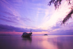 Sunset Ship. Lonely ship on beach at sunset moment. great clouds Royalty Free Stock Photography