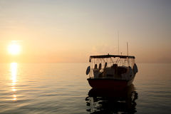 Sunset and the ship in the maldives Royalty Free Stock Photos