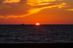 Sunset with ship moving. Moving ship at summer sea Stock Photography