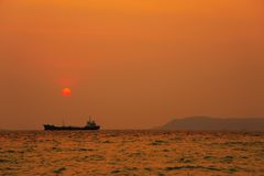 Sunset. The ship and sunset by the sea Royalty Free Stock Photo