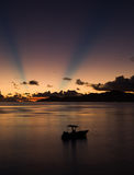 Sunset, ship, sunbeams and pink sky over the Indian Ocean. Royalty Free Stock Images