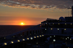 Sunset on ship Stock Images