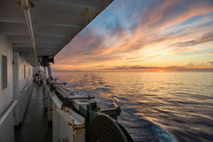 A ship in the sea at sunset. White Sea, Russia. Sunset from the ship in the White Sea in the north of Russia Royalty Free Stock Photo