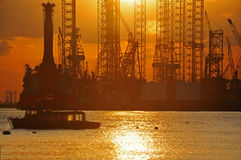Sunset and shipyard. At the sea side Royalty Free Stock Photos