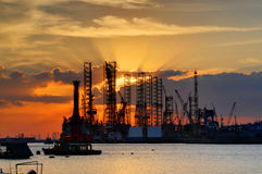 Sunset and shipyard. At the sea side Royalty Free Stock Image