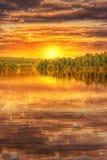 Sunset on the shore of lake royalty free stock photo