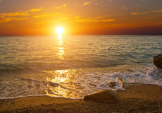 Sunset on the shore of sea Royalty Free Stock Image