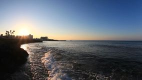 Sunset and sea waves in the Mediterranean Sea stock video