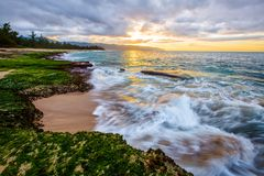 North Shore Hawaii Sunset. Sunset on the shores of the Pacific Ocean on Oahu`s North Shore in Hawaii royalty free stock photo