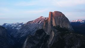 Sunset shot of half dome and Nevada falls from glacier point. In Yosemite national park stock footage