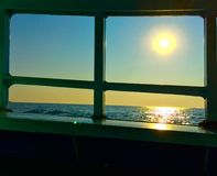 Sunset shot through the window. Sunshine is the sea reflection Stock Photo