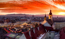 Sunset in Sibiu Transylvania, Romania, with Christmas Market visible Royalty Free Stock Photos