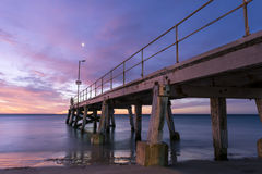 Sunset from the side of the Normanville Jetty Royalty Free Stock Images