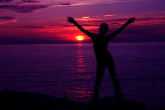 Sunset Silhoette. Silhoette of girl and purple sunset Royalty Free Stock Photography