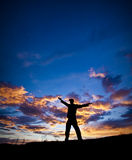 Sunset Silhouette. A silhouette of person excited and happy to be outdoors in a beautiful location Royalty Free Stock Photos
