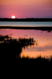 Sunset Silhouette. A Beautiful Sunset with the Marsh as a Silhouette royalty free stock photo