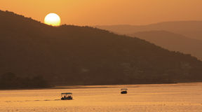 Sunset Silhouette. Beautiful sunset over river in Asia Stock Photo