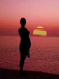 Sunset Silhouette. A sunset over the atlantic ocean with a silhouette of a woman in tenerife stock photography
