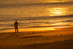 Sunset with Silhouette. Man playing in the ocean at sunset Royalty Free Stock Photography