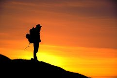 Sunset silhouette. Silhouette  of the climber during sunset Royalty Free Stock Image