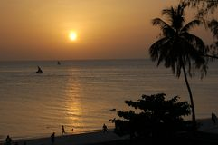 Sunset Silhouette. Sunset in Stone Town beach, Zanzibar, Tanzania stock photo