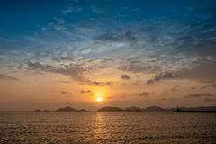 Sunset. Silhouette sunset behind island from thailand Royalty Free Stock Image