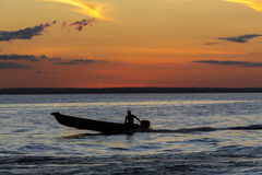 Sunset and silhouette on boat cruising the Amazon River, Brazil Royalty Free Stock Images