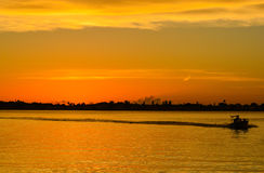 Sunset with the silhouette of a boat on the inter coastal in Belleair Bluffs, FloridaSunset with the silhouette of a boat on the i. Sunset with the silhouette of Stock Photos