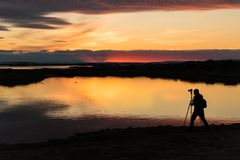 Sunset with a silhouette of a cameraman at Myvatn Iceland stock image