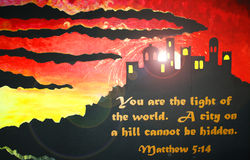 Sunset silhouette of A City on a Hill. City on a Hill silhouetted against sunset with scripture verse Matthew 5:16 Stock Photos