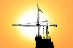Sunset and silhouette construction Royalty Free Stock Photo