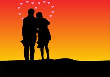 Sunset silhouette of a couple Stock Images