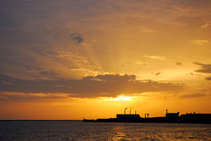 Sunset silhouette of factory Stock Photography