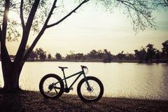 Sunset silhouette of fat bike Stock Image