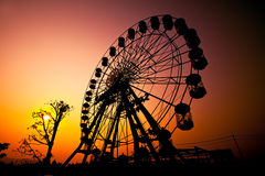 Sunset silhouette of Ferris wheel Royalty Free Stock Image