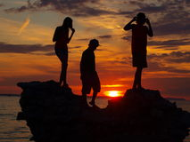 Sunset - silhouette figures Stock Images