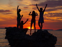 Sunset - silhouette figures Stock Photos
