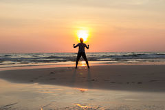 Sunset Silhouette human life and activity on the beach at Stock Image
