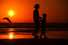 Sunset silhouette of Little brother and sister Stock Images