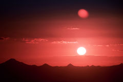 Sunset silhouette over the mountain Stock Photo