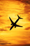 Sunset silhouette of passenger aircraft. Passenger aircraft jet silhouette sunset Royalty Free Stock Photos