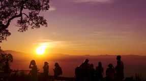 Sunset silhouette  people Stock Photography