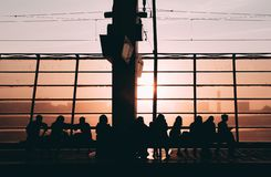 Sunset silhouette people railway station royalty free stock image