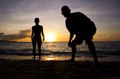 Sunset Silhouette - People. Silhouette  shot of a male & female figure on the beach at sunset Stock Image