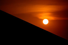 Sunset and silhouette roof. Focus at sun Royalty Free Stock Photos